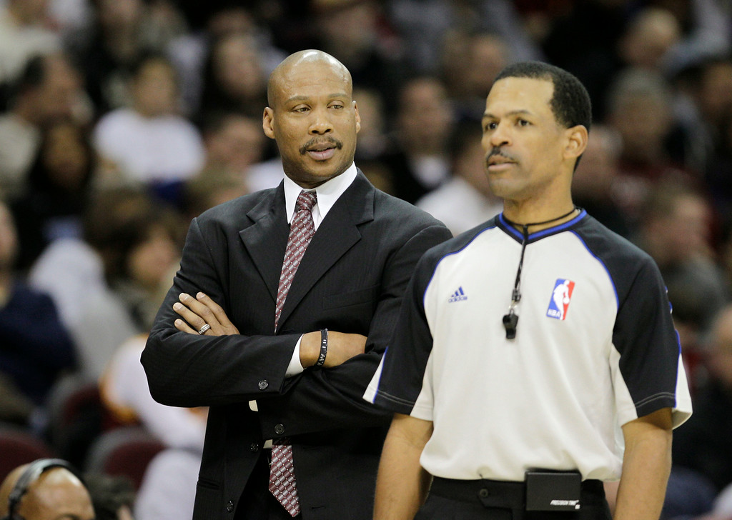 . Cleveland Cavaliers head coach Byron Scott, left, talks to referee Eric Lewis during an NBA basketball game against the Orlando Magic Tuesday, Dec. 28, 2010, in Cleveland. (AP Photo/Mark Duncan)