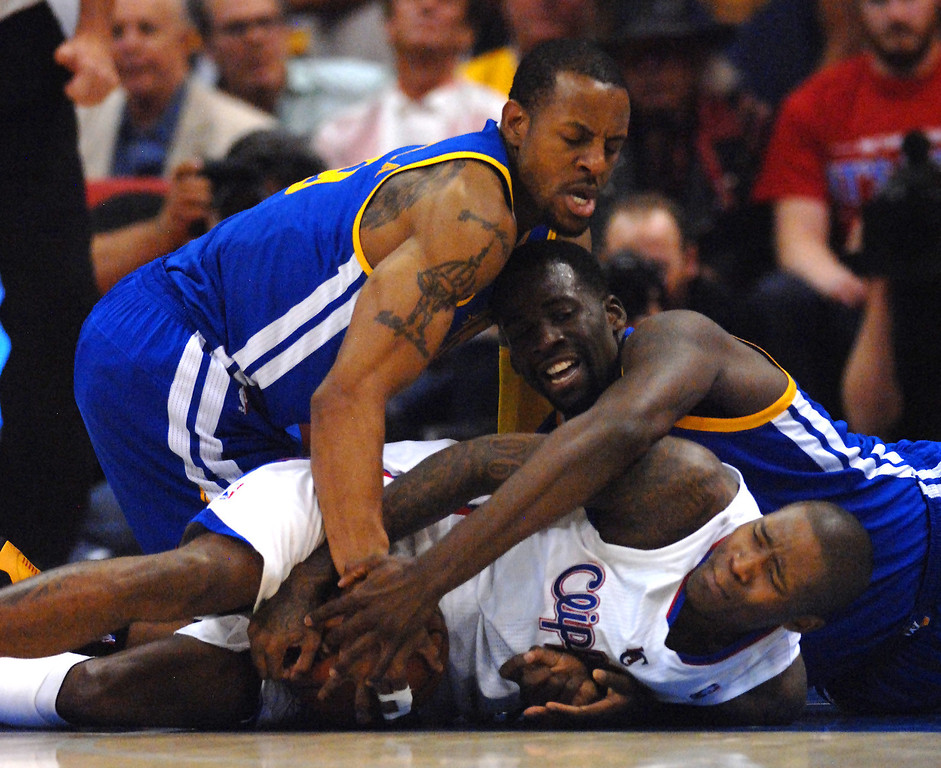 . The Clippers\' Jamal Crawford tries to protect the ball from the Warriors\' Andre Iguodala, left, and Draymond Green in game seven of the Western Conference playoffs, Saturday, May 3, 2014, at Staples Center. (Photo by Michael Owen Baker/L.A. Daily News)