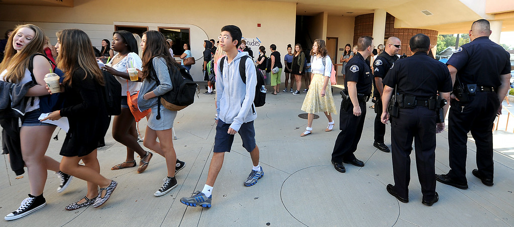 . Police presence on South Pasadena High School first day back to school Thursday, August 21, 2014. This the the campus where a 16- and 17-year-old boy allegedly planned a mass shooting to kill three staff members and as many students as possible, Police Chief Arthur Miller said. The Los Angeles County District Attorney\'s Office on Wednesday charged both boys with one count of making criminal threats. The D.A. has not charged the teens for conspiracy to commit a mass shooting, just a shooting. (Photo by Walt Mancini/Pasadena Star-News)