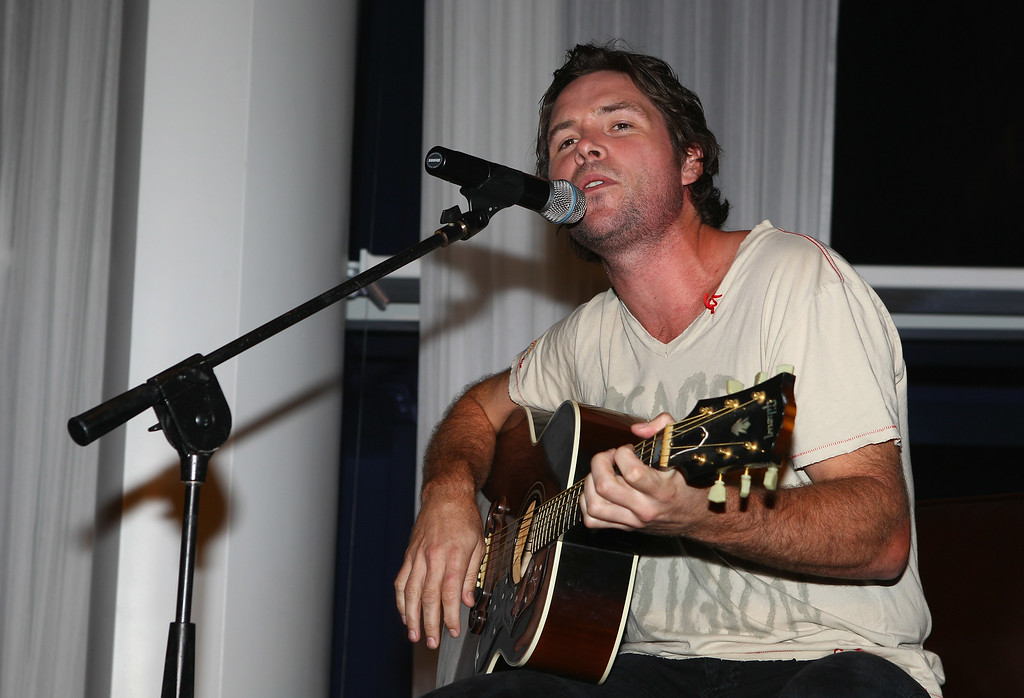 . Michael Johns of American Idol sings after the Birdies for Breast Cancer Foundation Liberty Cup at Liberty National Golf Club on August 30, 2011 in Jersey City, New Jersey.  (Photo by Scott Halleran/Getty Images)