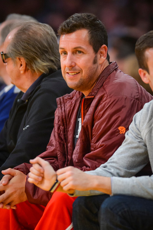 . Adam Sandler looks on as the Lakers took on the Houston Rockets  at Staples Center Wednesday, February 19, 2014.  The Rockets defeated the Lakers 134-108.  ( Photo by David Crane/Los Angeles Daily News )