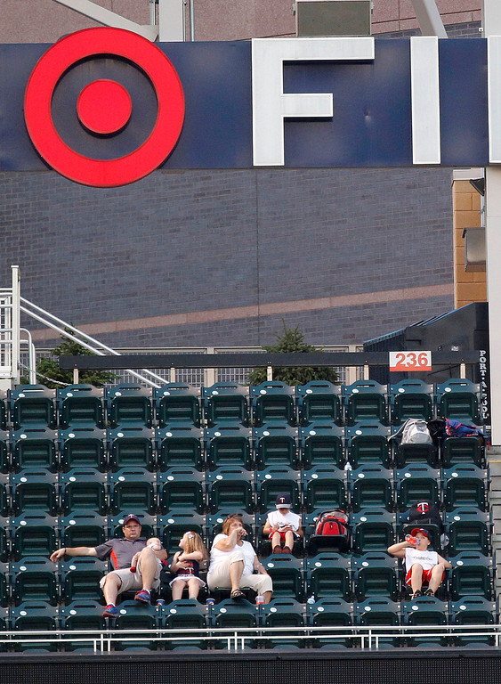 . The crowd was thin at Target Field for a make-up game between the Los Angeles Angels and the Minnesota Twins as temperatures climbed to the 90\'s during the baseball game which was canceled in April due to snow in Minneapolis Monday, Sept. 9, 2013.(AP Photo/Andy Clayton-King)