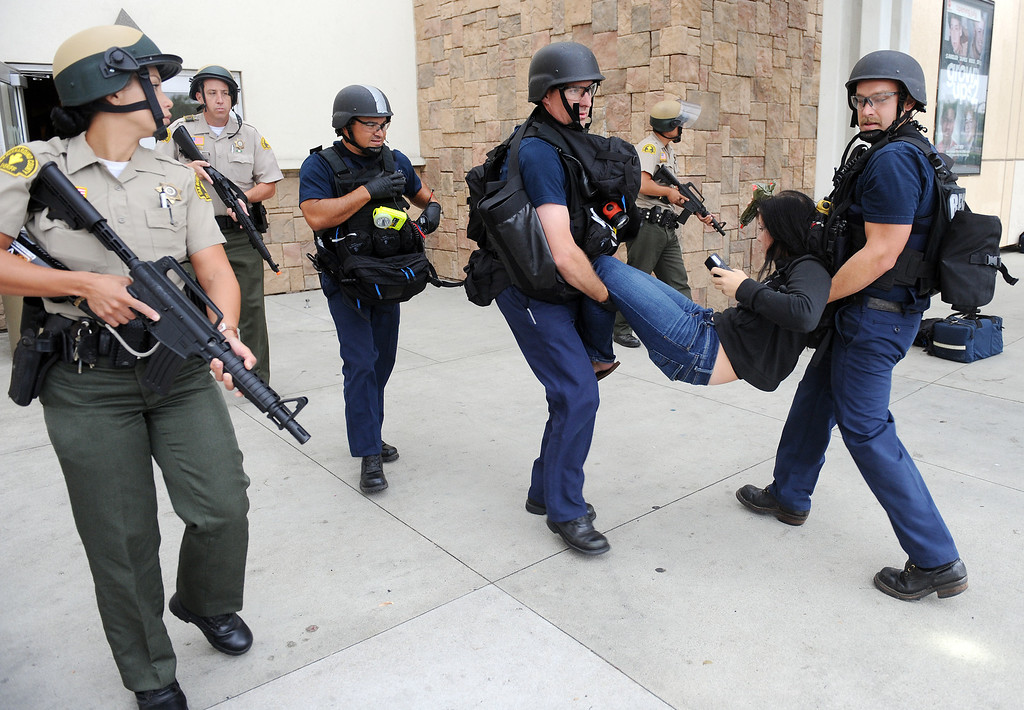 . (Will Lester/Inland Valley Daily Bulletin) Rancho Cucamonga Sheriff deputies and Rancho Cucamonga fire department personnel took carry a victim out a shooting victim during a mock theater shooting training drill Thursday morning August 1, 2013 at Victoria Gardens in Rancho Cucamonga.