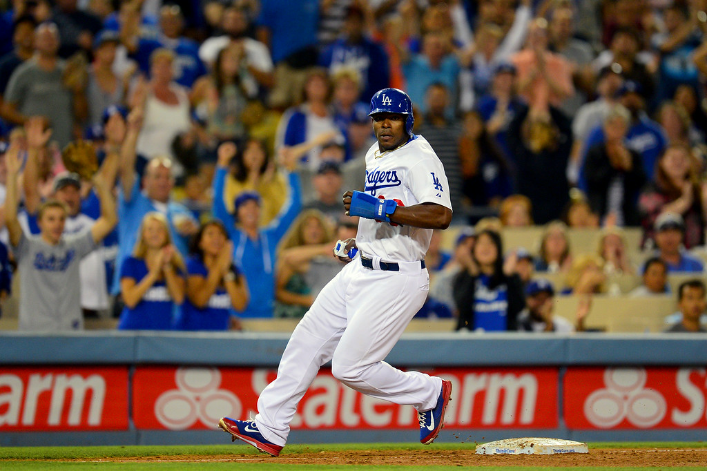. The Dodgers\' Yasiel Puig advances to third on a throwing error by Mets shortstop Wilmer Flores in the seventh inning. (Photo by Michael Owen Baker/Los Angeles Daily News)