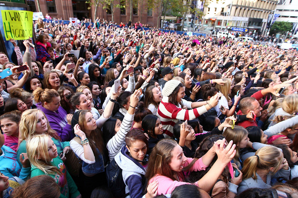. A large crowd of mostly young girls gather at a television station where British boy band One Direction is appearing in Sydney, Wednesday, April 11, 2012. (AP Photo/Rick Rycroft)