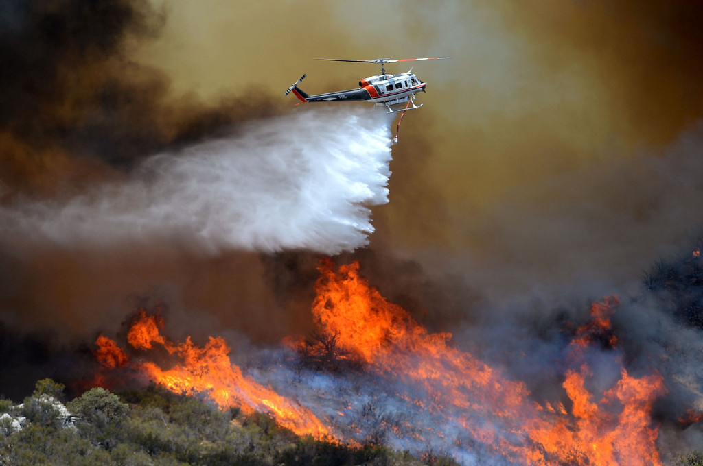 . A fire helicopter makes a drop on the PowerhouseFire near Green Valley, CA Friday, May 31, 2013.(Andy Holzman/Staff Photographer)