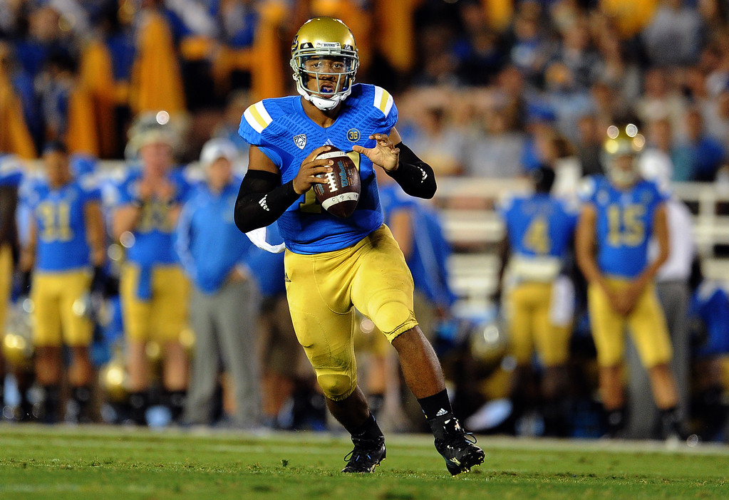 . UCLA quarterback Brett Hundley passes against New Mexico State during the first half of their college football game in the Rose Bowl in Pasadena, Calif., on Saturday, Sept. 21, 2013.   (Keith Birmingham Pasadena Star-News)
