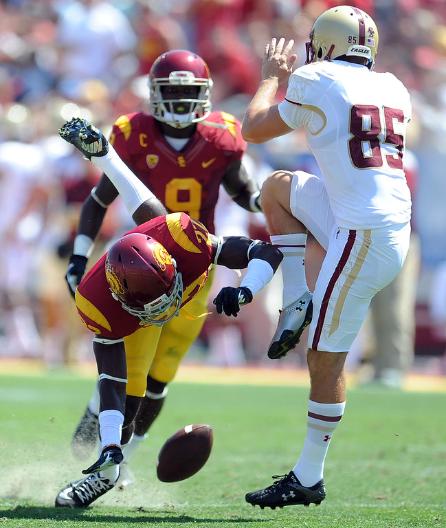 . Southern California safety Leon McQuay III (22) blocks a punt by Boston College kicker Nate Freese (85) during the first half of an NCAA college football game in the Los Angeles Memorial Coliseum in Los Angeles, on Saturday, Sept. 14, 2013. The play was called back due to an off sides call against Southern California.