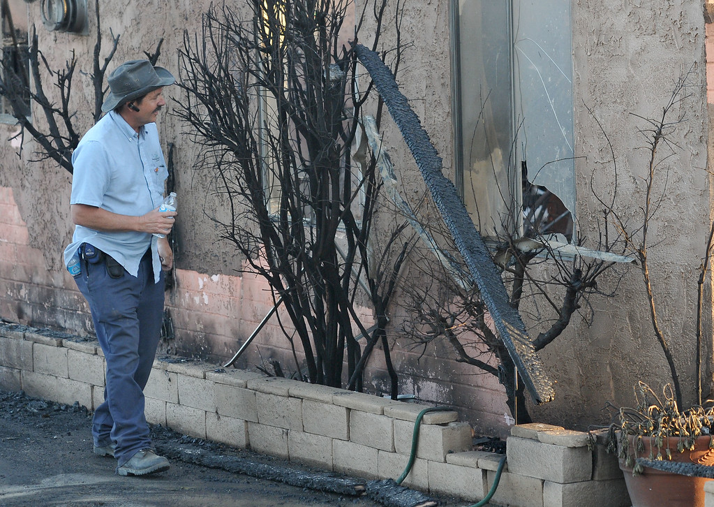 . (John Valenzuela/Staff Photographer)  Joe Kiener of Banning looks at some of the destruction after a fire burned his house on Wednesday afternoon, May 1, 2013. Cal Fire battled a brush  fire that ignited about 12:38 p.m. today and has since grown to 1,700 acres, according to Cal Fire officials.