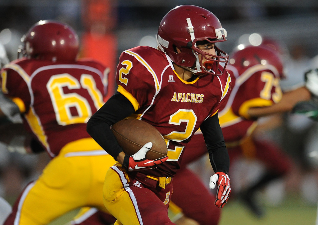 . Arcadia\'s Robbie Hillier (2) runs for yardage against Monrovia in the first half of a prep football game at Arcadia High School in Arcadia, Calif. on Friday, Sept. 13, 2013.   (Photo by Keith Birmingham/Pasadena Star-News)