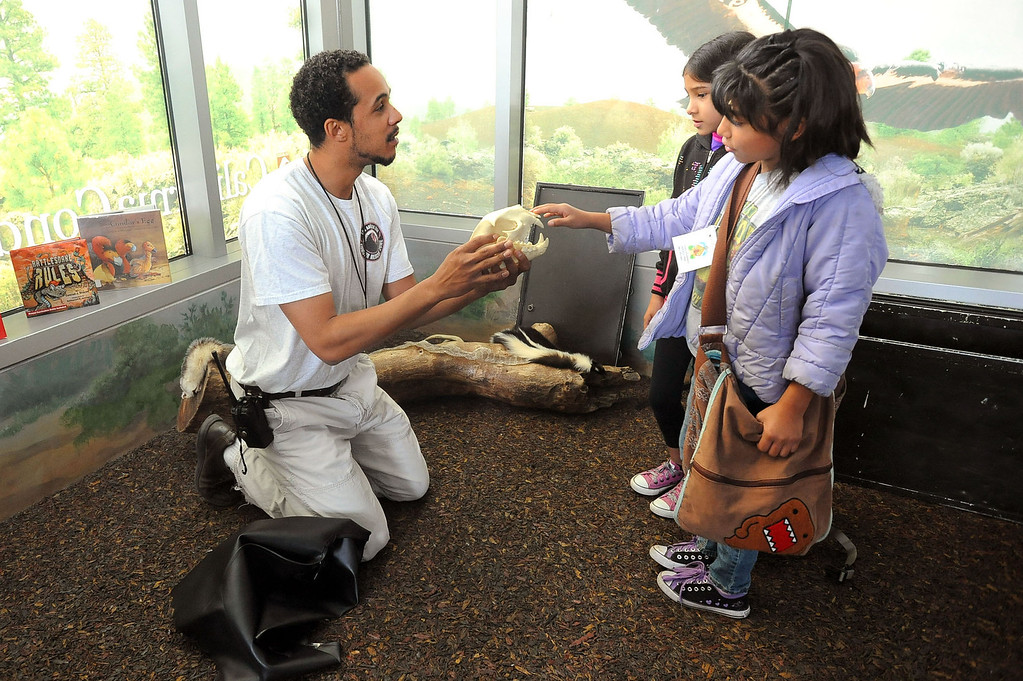 . Education Curator Sean Den Bok (cq) works with youngsters in the California Condor Rescue Zone at the Los Angeles Zoo May 9, 2013.  The L.A. Zoo has long participated in a federal program to help save the endangered bird, of which just 225 live in the wild.(Andy Holzman/Staff Photographer)