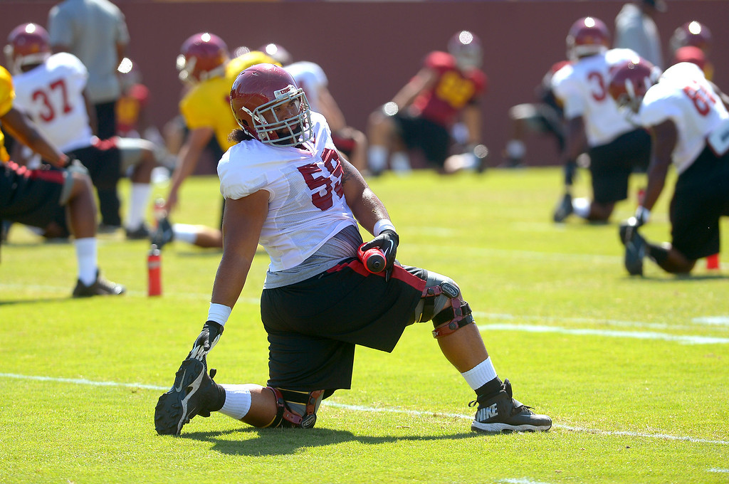 . Players prepare for USC football practice August 20, 2013.(Andy Holzman/Los Angeles Daily News)