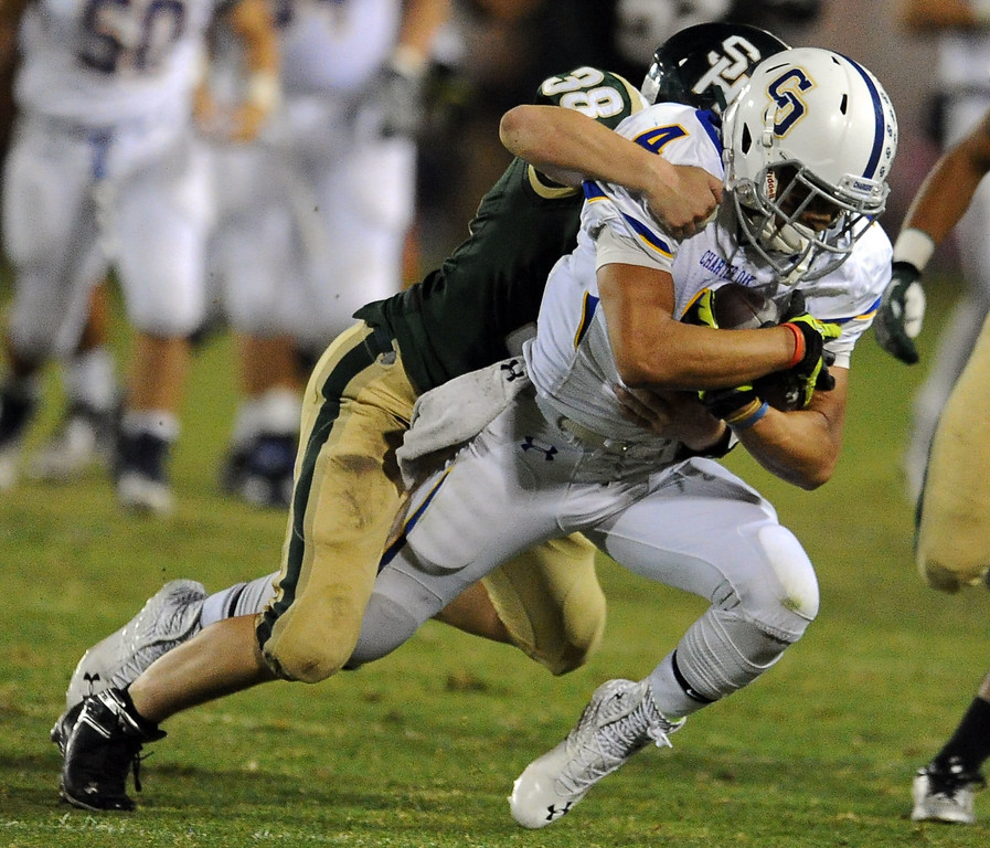 . Charter Oak\'s Donavin Washington (4) is tackled by South Hills\' Mason Behr (38) after running for a first down in the first half of a prep football game at Covina DIstrict Field in Covina, Calif., on Thursday, Oct. 24, 2013. 