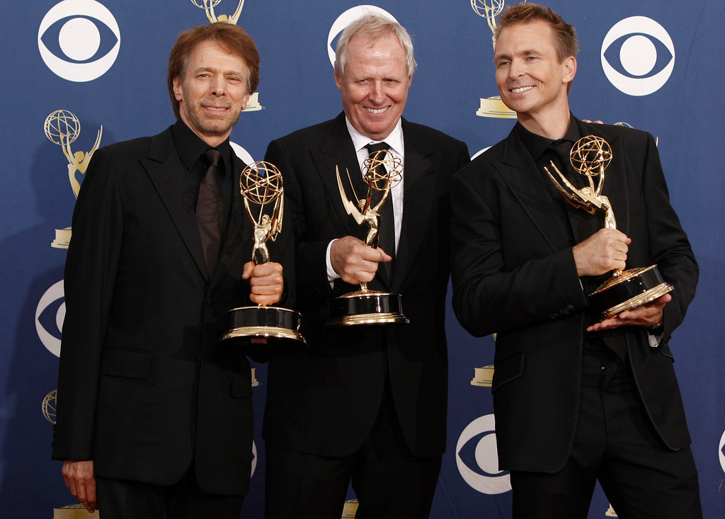 """. Executvie pruducers from left,  Jerry Bruckheimer,  Bertram van Munster, center, and host Phil Keoghan pose with the award for outstanding reality-competition program for \""""The Amazing Race\""""  backstage at the 61st Primetime Emmy Awards on Sunday, Sept. 20, 2009, in Los Angeles. (AP Photo/Matt Sayles)"""