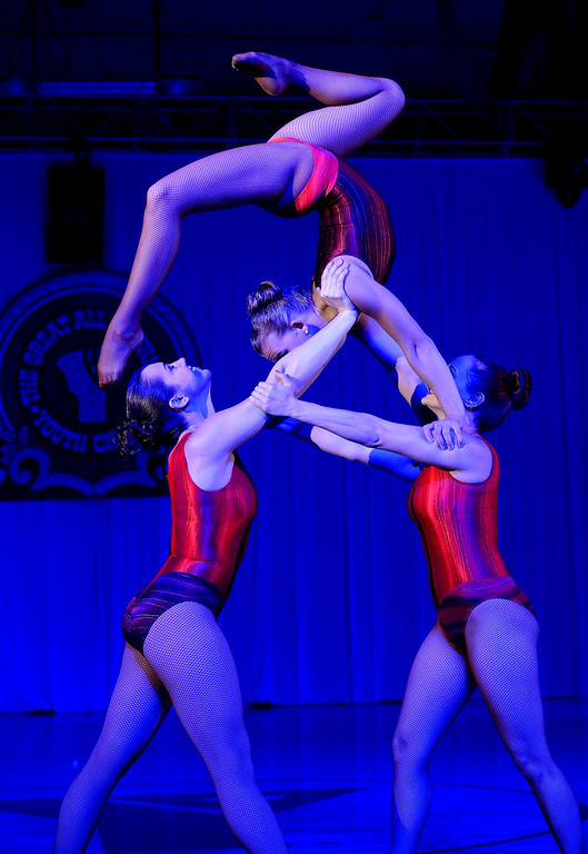 . Clockwise from bottom left: Heather Pivaral, Jennifer Taylor, and Courtney Pratt perform during the Great Y Circus in Redlands May 3, 2013.  GABRIEL LUIS ACOSTA/STAFF PHOTOGRAPHER.