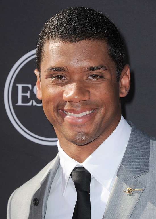 . NFL player Russell Wilson arrives at the ESPY Awards on Wednesday, July 17, 2013, at Nokia Theater in Los Angeles. (Photo by Jordan Strauss/Invision/AP)
