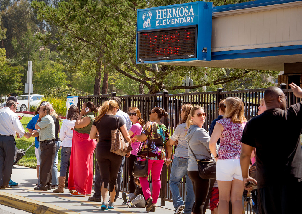. Parents pick up Hermosa Elementary School students evacuating due to the Etiwanda Fire in Ranco Cucamonga, Calif. April 30, 2014.  (Staff photo by Leo Jarzomb/San Gabriel Valley Tribune)