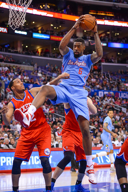 . Clippers� DeAndre Jordan comes up with the rebound as 76ers� Evan Turner defends on the play during first half action at Staples Center Sunday.  ( Photo by David Crane/Los Angeles Daily News )