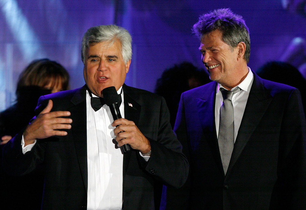 . BEVERLY HILLS, CA - OCTOBER 28:  Host Jay Leno (L) and producer David Foster speak during at the 17th Annual Mercedes-Benz Carousel of Hope Ball at the Beverly Hilton Hotel on October 28, 2006 in Beverly Hills, California.  (Photo by Kevin Winter/Getty Images)