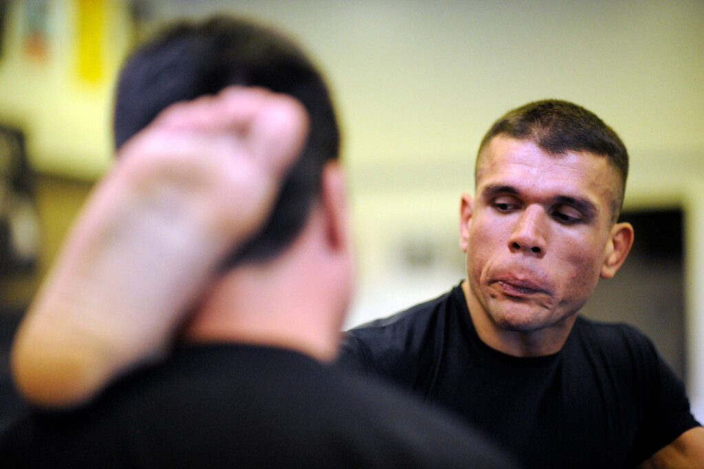 . Head instructor Mark Parra helps UFC Fighter Eddie Mendez stretch before training at the House of Champions in Van Nuys. (Hans Gutknecht/Los Angeles Daily News)