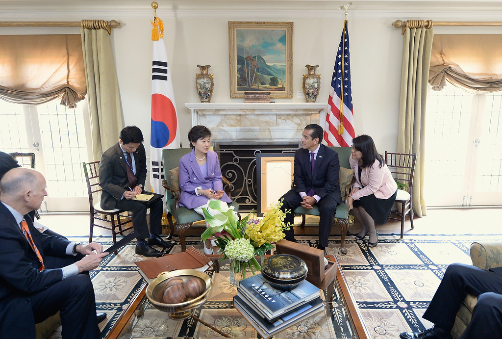 . South Korean President Park Geun-hye (3rd L) speaks with Los Angeles Mayor Antonio Villaraigosa (2nd R) and California Governor Jerry Brown (L) as their translators listen in the foyer of Getty House after arriving for a welcoming luncheon on May 9, 2013 in Los Angeles, California.  (Photo by Kevork Djansezian/Getty Images)