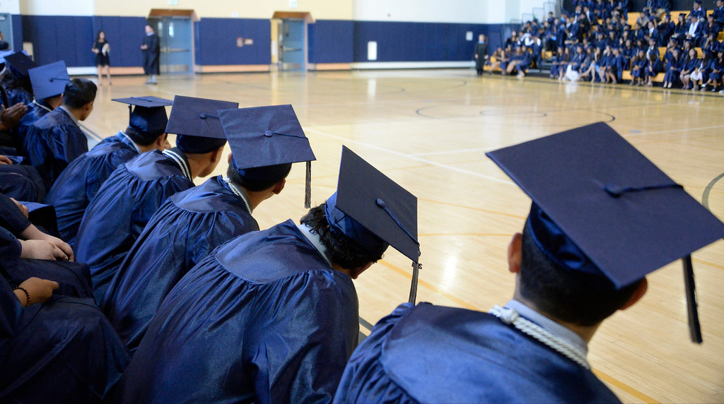 . June 6,2014 PANORAMA city, California. Grads wait for their names to be called to get in line, during the Panorama High graduating class of 2014. Photo by Gene Blevins/LA Daily News