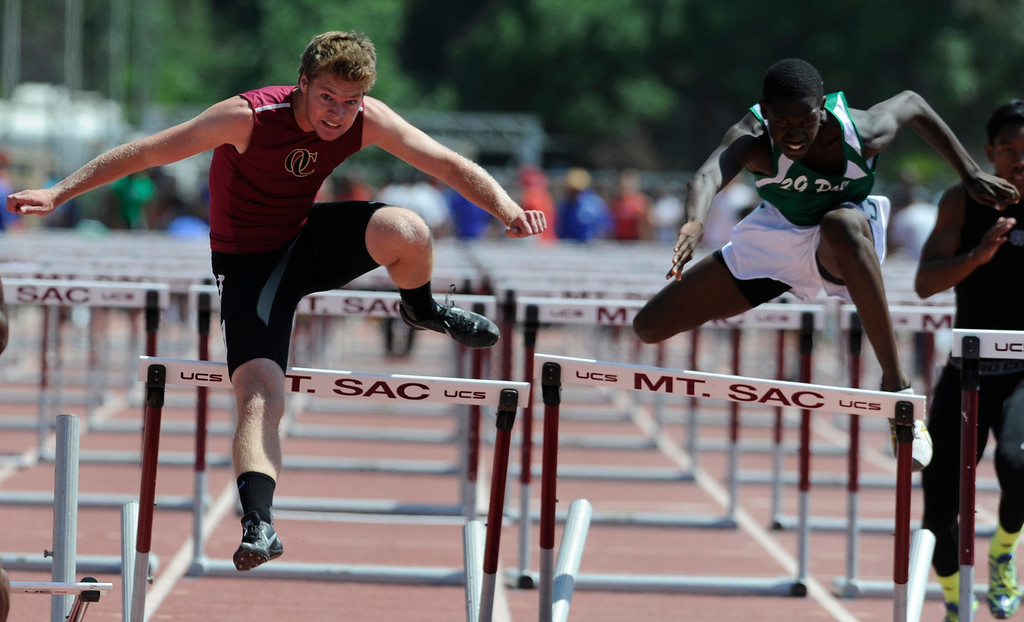 . Oaks Christian Jordan Pitcher manages to get past Twentynine Palms Diante Aiken, who stumbled during the boys 110 meter high hurdles in the 2013 CIF Southern Section Track & Field Divisional Finals held at Mt. San Antonio College in Walnut, CA 5/18/2013(John McCoy/LA Daily News)