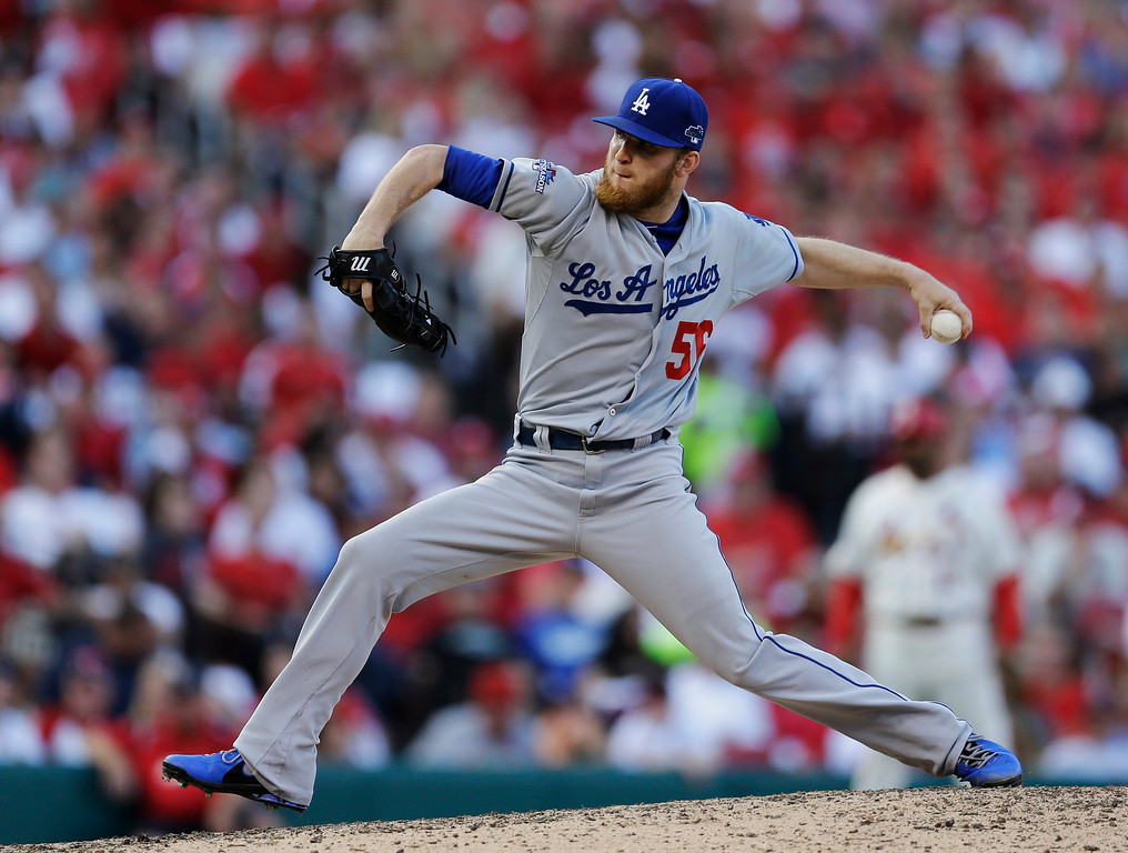 . Los Angeles Dodgers relief pitcher J.P. Howell throws during the eighth inning of Game 2 of the National League baseball championship series against the St. Louis Cardinals Saturday, Oct. 12, 2013, in St. Louis. (AP Photo/Jeff Roberson)