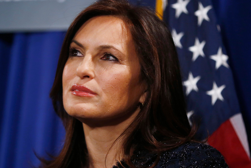 . Actress Mariska Hargitay, of Law and Order Special Victims Unit, listens as Vice President Joe Biden, not pictured, speaks about reducing domestic violence, Wednesday, March 13, 2013, at the Montgomery County Executive Office Building in Rockville, Md.  (AP Photo/Charles Dharapak)