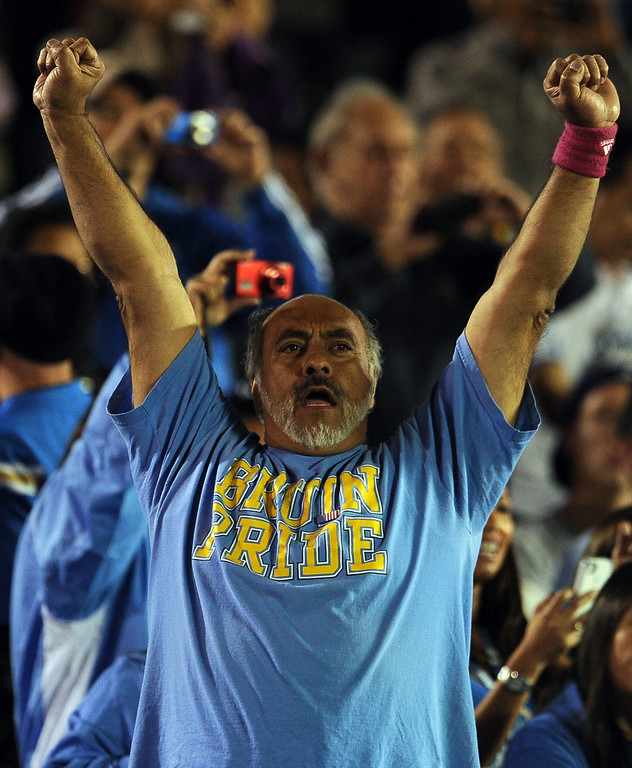 . UCLA fan reacts after a touchdown against California during the first half of their college football game in the Rose Bowl in Pasadena, Calif., on Saturday, Oct. 12, 2013.   (Keith Birmingham Pasadena Star-News)