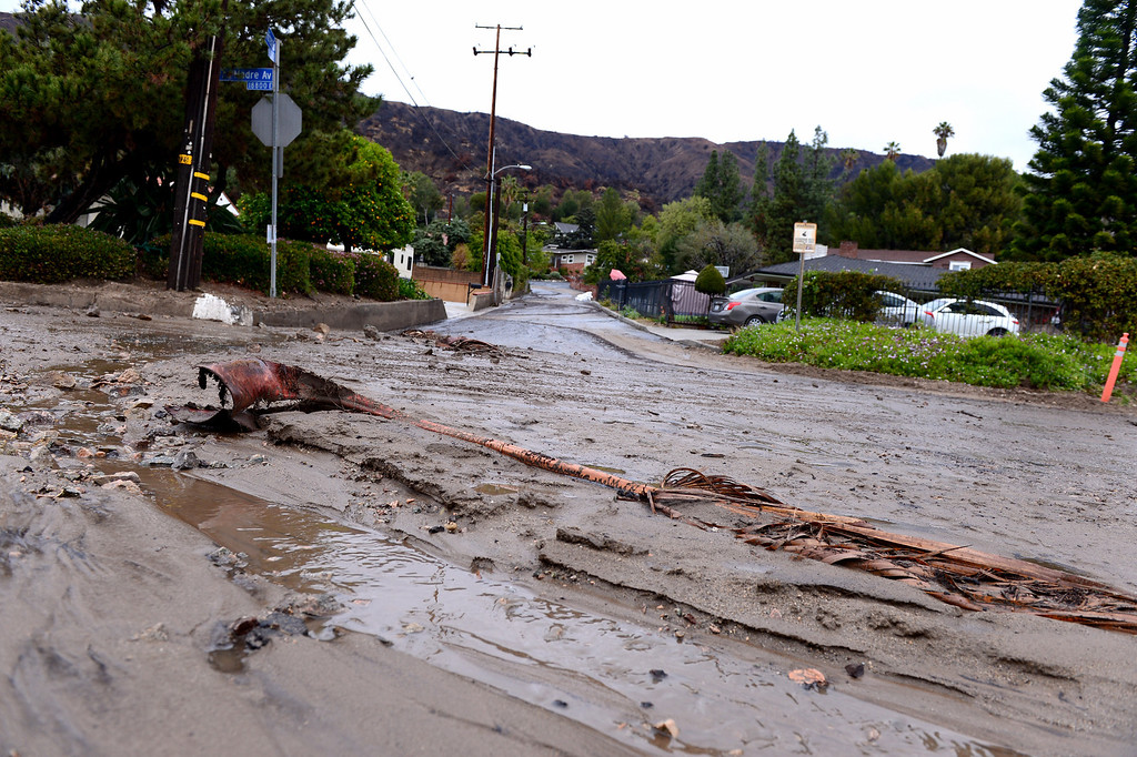 . Water and mud flows down Hicrest Road at Sierra Madre Avenue in Glendora, an area officials have kept closed Saturday, March 1, 2014. The area sits below the Colby Fire burn area. (Photo by Sarah Reingewirtz/Pasadena Star-News)