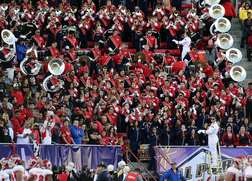 . LAS VEGAS, NV - DECEMBER 21:  Members of the Fresno State Bulldogs marching band perform in the stands as the team takes on the USC Trojans in the Royal Purple Las Vegas Bowl at Sam Boyd Stadium on December 21, 2013 in Las Vegas, Nevada. USC won 45-20.  (Photo by Ethan Miller/Getty Images)