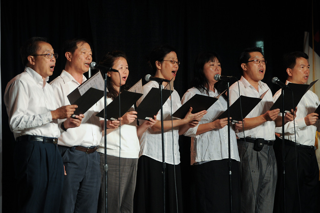 """. Members of the Chinese Christian Alliance Church choir sing \""""Amazing Grace\"""" at a prayer vigil at West Valley Christian School, Thursday, July 11, 2013, in honor of the crash victims of Asiana Flight 214 airliner that crashed at San Francisco Airport. (Michael Owen Baker/L.A. Daily News)"""