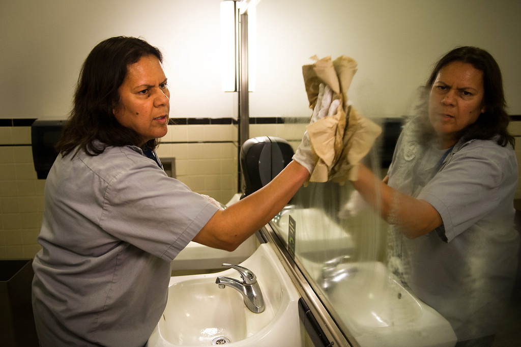. Custodian Sanjuana Salas cleans a bathroom mirror at L.A. City Hall, Tuesday, March 18, 2014. (Photo by Michael Owen Baker/L.A. Daily News)