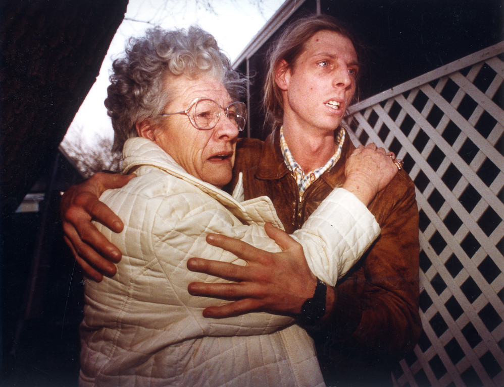 . Nannette Stone is held by her son, David, as a neighbor\'s mobile home burns at the Tahitian mobile home park on Cobalt Street in Sylmar.   Los Angeles Daily News file photo