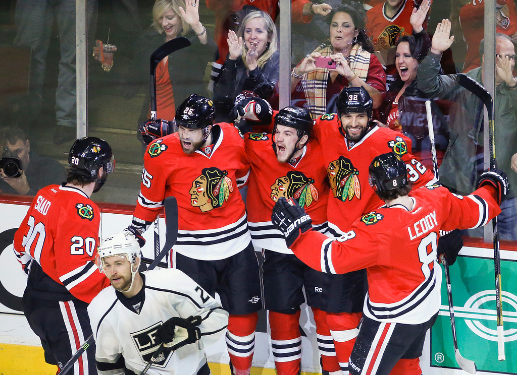 . The Chicago Blackhawks celebrate after  center Andrew Shaw (65) scored a goal against the Los Angeles Kings during the first period in Game 2 of the NHL hockey Stanley Cup Western Conference finals Sunday, June 2, 2013 in Chicago. The Blackhawks won 2-1. (AP Photo/Charles Rex Arbogast)