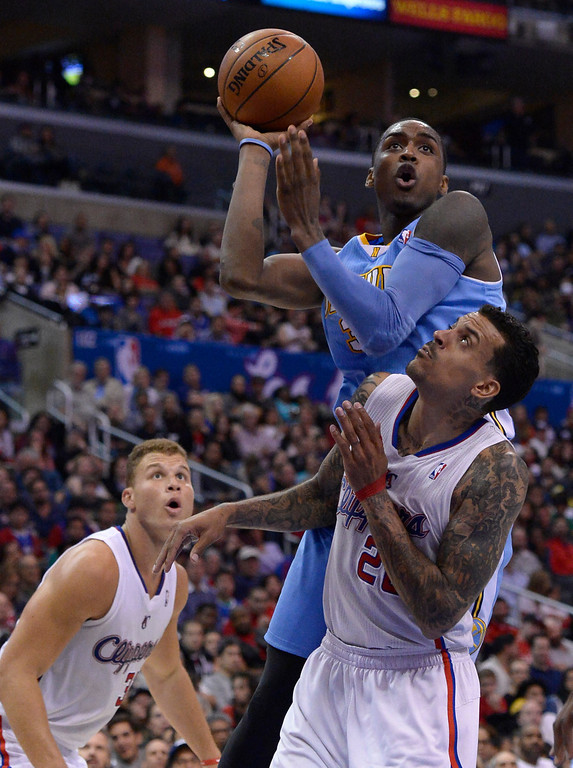. Denver#30 Quincy Miller shoots over Clippers#22 Matt Barnes in the second half. The Los Angeles Clippers defeated Denver Nuggets 117 to 105 in a regular season NBA game. Los Angeles, CA. 4/15/2014(Photo by John McCoy / Los Angeles Daily News)