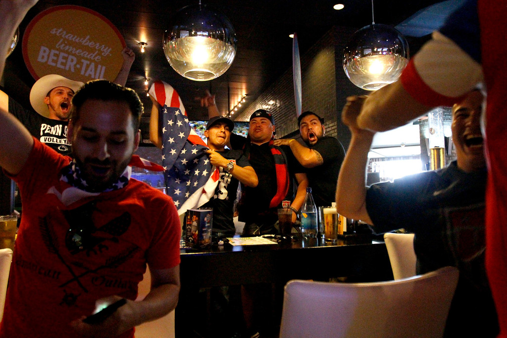 . From left, Eddie Gonzales, of Diamond Bar, Tony Aguro, of Riverside, Jonathan Navarrete, of Riverside, Danny Ramirez, of Riverside, and Brian Corado, of Santa Ana, celebrate after team USA\'s Clint Dempsey scores the first goal during a World Cup soccer match against Ghana on Monday, June 16, 2014 at Dave and Busters in Ontario, Ca. (Micah Escamilla/Inland Valley Daily Bulletin)