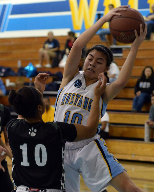 . Walnut\'s Katya Echavez (10) rebounds past Bonita\'s Nikki Wheatley (C) (10) in the second half of a prep basketball game at Walnut High School in Walnut, Calif., on Wednesday, Jan. 15, 2014. Bonita won 60-50. (Keith Birmingham Pasadena Star-News)