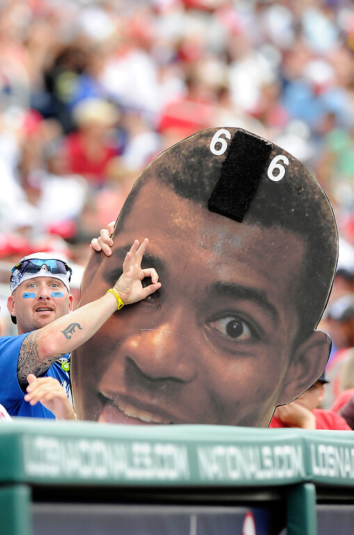 . WASHINGTON, DC - JULY 21: A fan holds up a Yasiel Puig #66 cutout head during the game between the Los Angeles Dodgers and the Washington Nationals at Nationals Park on July 21, 2013 in Washington, DC.  (Photo by Greg Fiume/Getty Images)
