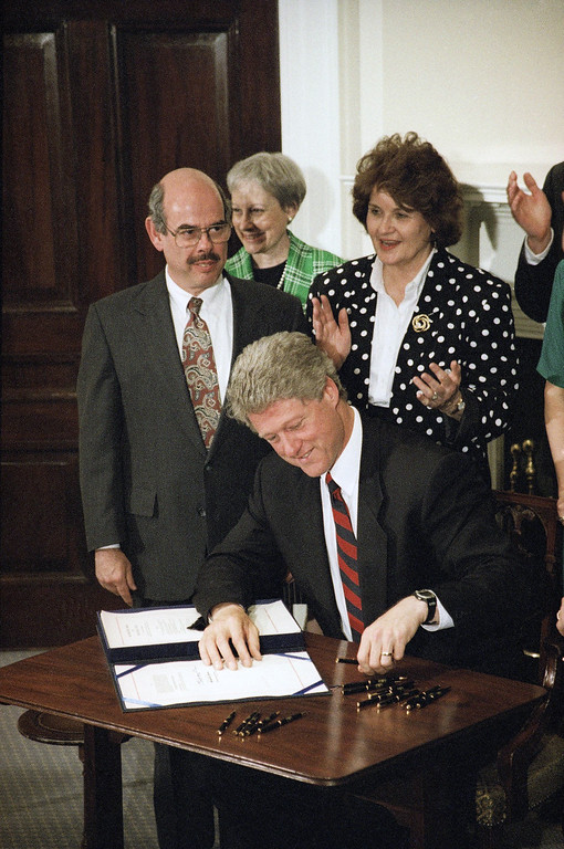 . Rep. Henry Waxman, D-Calif., looks on left as President Bill Clinton signs the National Institutes of Health Act at the White House in Washington, Thursday, June 11, 1993.  (AP Photo/J. Scott Applewhite)