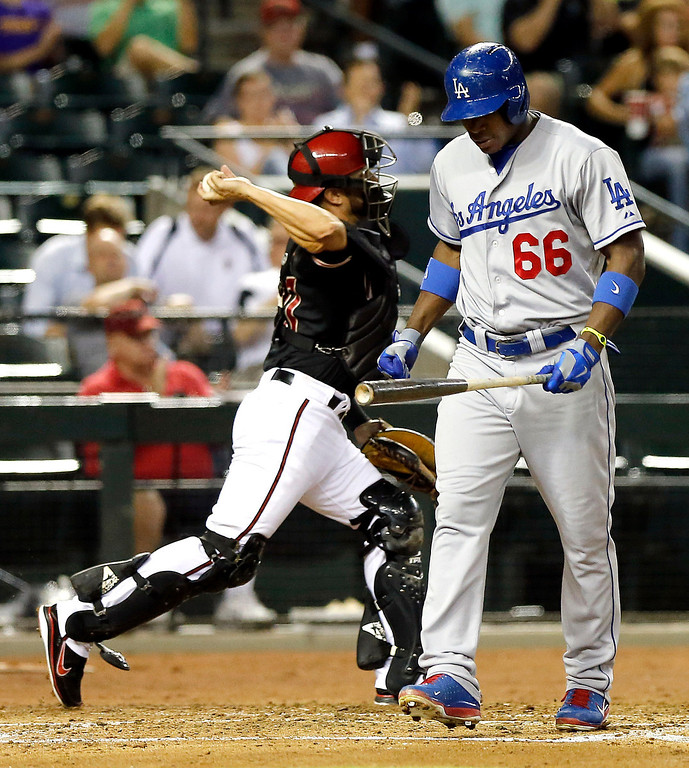 . Arizona Diamondbacks catcher Miguel Montero throws to third after Los Angeles Dodgers\' Yasiel Puig struck out during the third inning of a baseball game, Wednesday, July 10, 2013, in Phoenix. (AP Photo/Matt York)