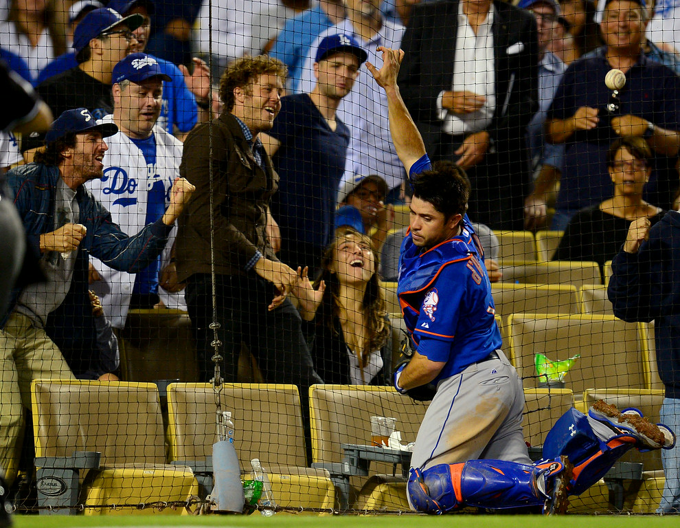. Fans react as Mets catcher Travis d\'Arnaud misses a popup behind the plate. (Photo by Michael Owen Baker/Los Angeles Daily News)