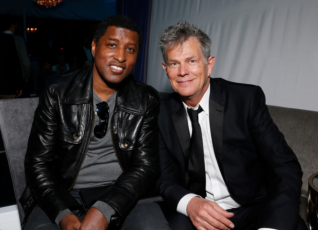 . Kenneth \'Babyface\' Edmonds and David Foster attend a Grammy Party hosted by Lucian Grainge on Sunday, Feb. 10, 2013 in Los Angeles. (Photo by Todd Williamson/Invision/AP)