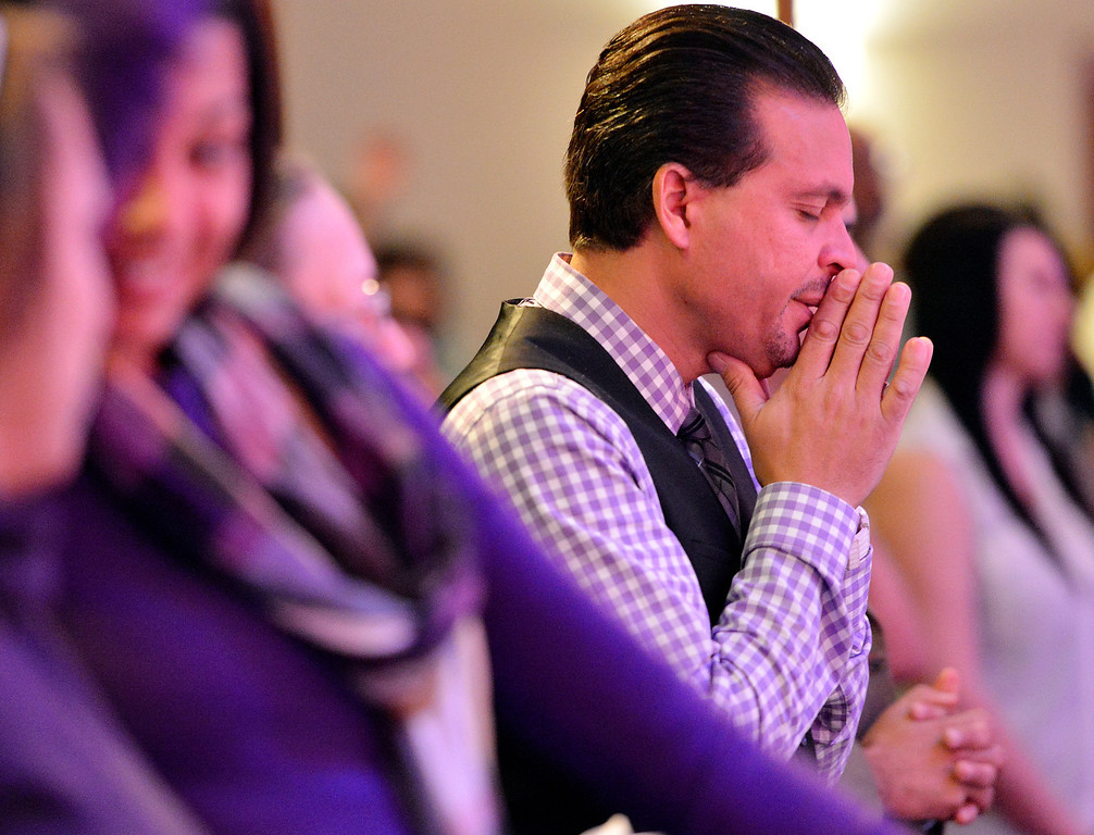 . Way World Outreach Church Pastor Marco Garcia prays with his congregation Sunday December 15, 2013 in San Bernardino. He is the co-founder of the rapidly growing church which has been generous in providing for the homeless and others in need. (Will Lester/Inland Valley Daily Bulletin)