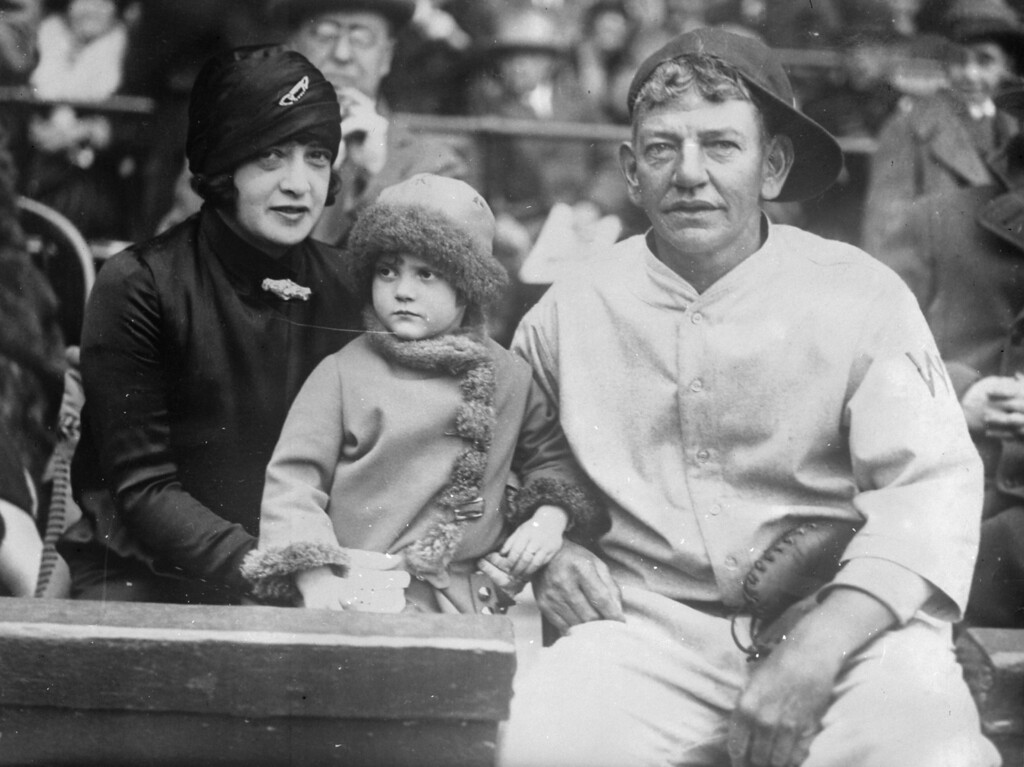 . Helen Woodford Ruth, the wife of baseball legend Babe Ruth, holds his child Dorothy Ruth and sits next to baseball player Nick Affrock.  (Photo by General Photographic Agency/Getty Images)