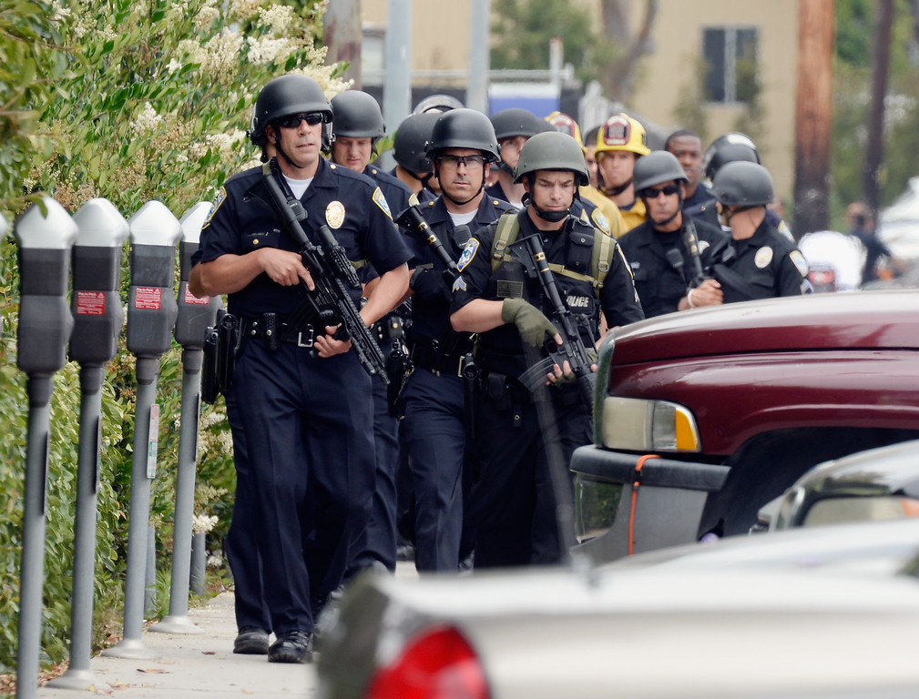. SANTA MONICA, CA - JUNE 07:  Santa Monica Police officers prepare to search the campus of Santa Monica College after multiple shootings were reported on the campus June 7, 2013 in Santa Monica, California. Six people were killed in the rampage, according to news reports. (Photo by Kevork Djansezian/Getty Images)