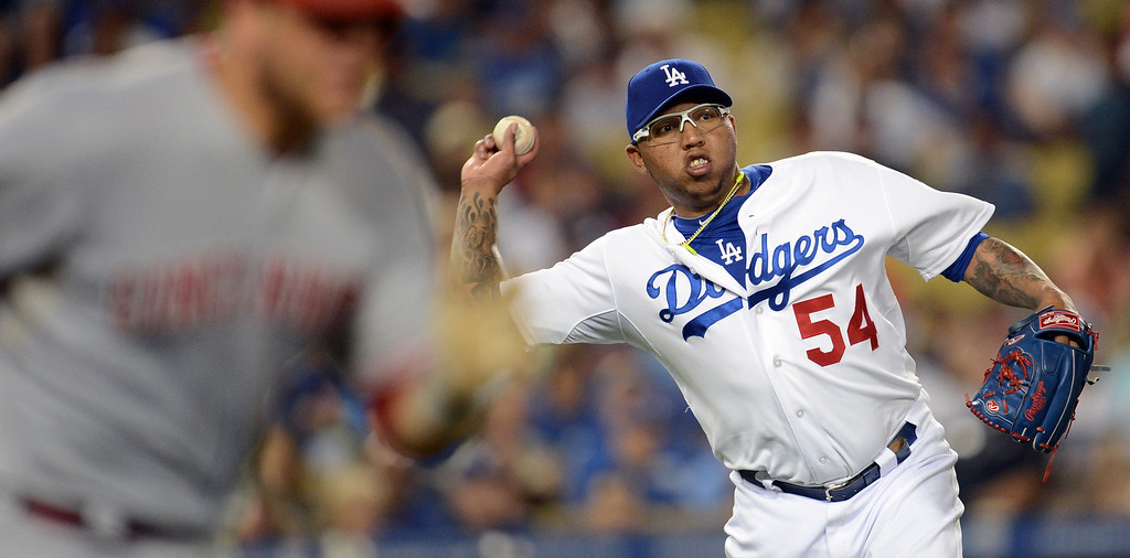 . The Dodgers\' Ronald Belisario #54 throws out the Reds\' Devin Mesoraco #39 in the 8th inning during their game at Dodger Stadium in Los Angeles Saturday, July 27, 2013. The Dodgers beat the Reds 4-1. (Hans Gutknecht/Los Angeles Daily News)