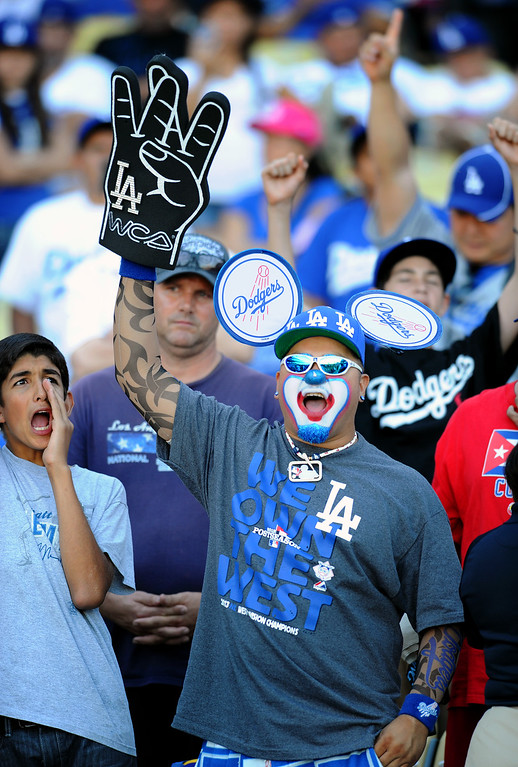 . Fans cheer during a post-game rally after the Dodgers-Rockies game, Sunday, Sept. 29, 2013, at Dodger Stadium. (Photo by Michael Owen Baker/L.A. Daily News)