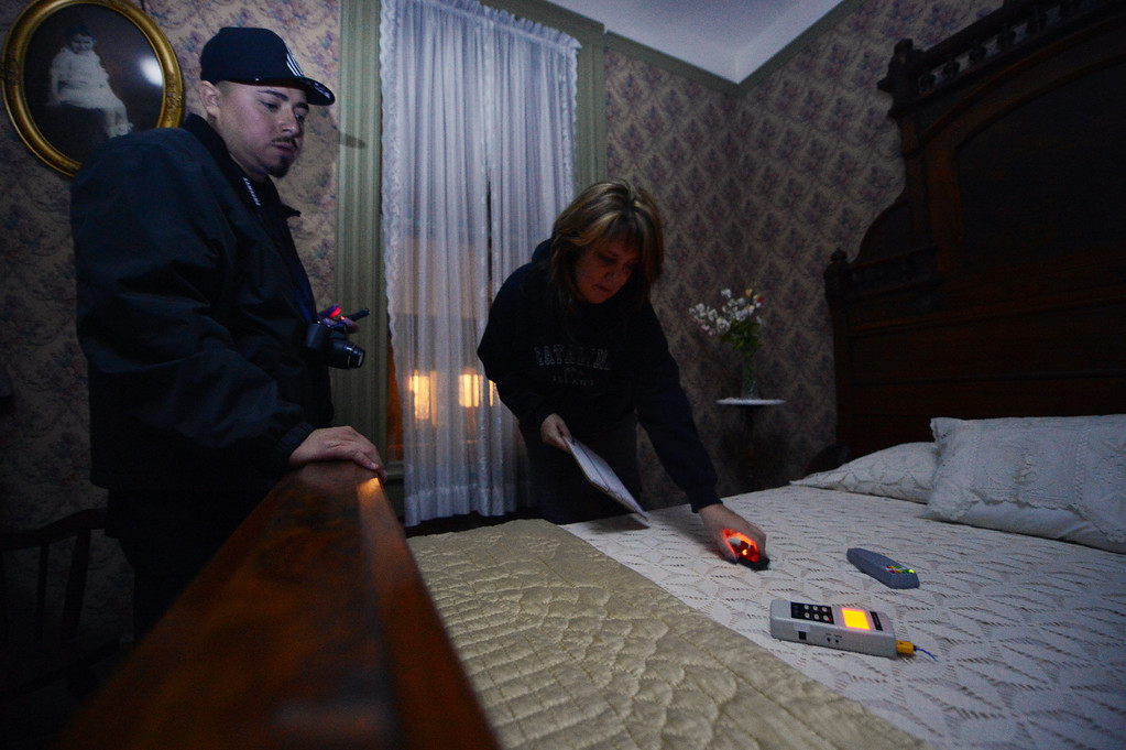 . Jacob Kire and Dani Greychik, of the Enlightened Paranormal Investigators of California, hunt for ghosts at the Santa Clarita Historical Heritage Junction in Newhall Friday, October 25, 2013. (Photo by Hans Gutknecht/Los Angeles Daily News)